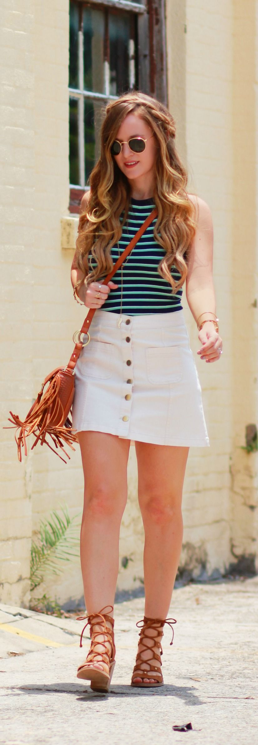 Striped halter top styled with white button up skirt and lace up sandals, casual summer outfit