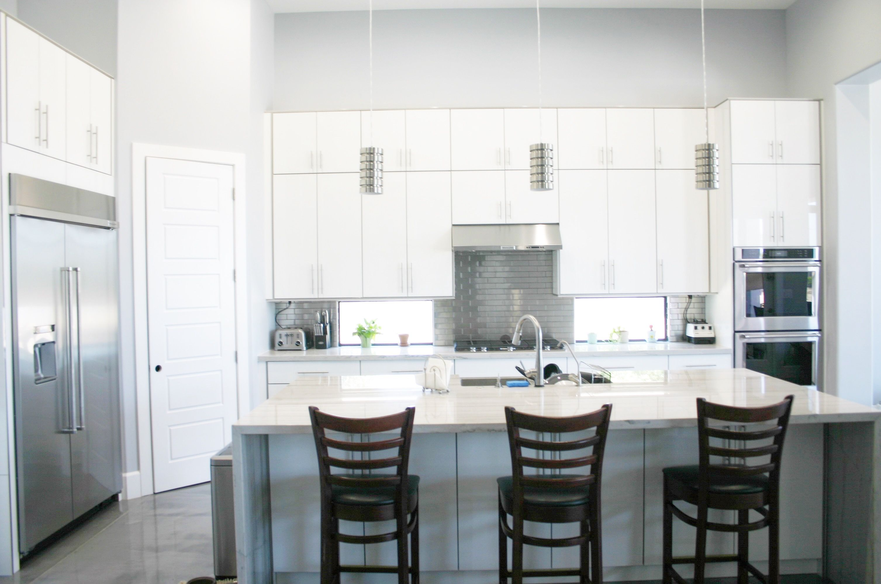 A Simplistic And Modern Frameless Acrylic Kitchen Metallic And Edge Banding On The Doors And Th Custom Kitchen Cabinets Custom Kitchens Custom Bathroom Vanity