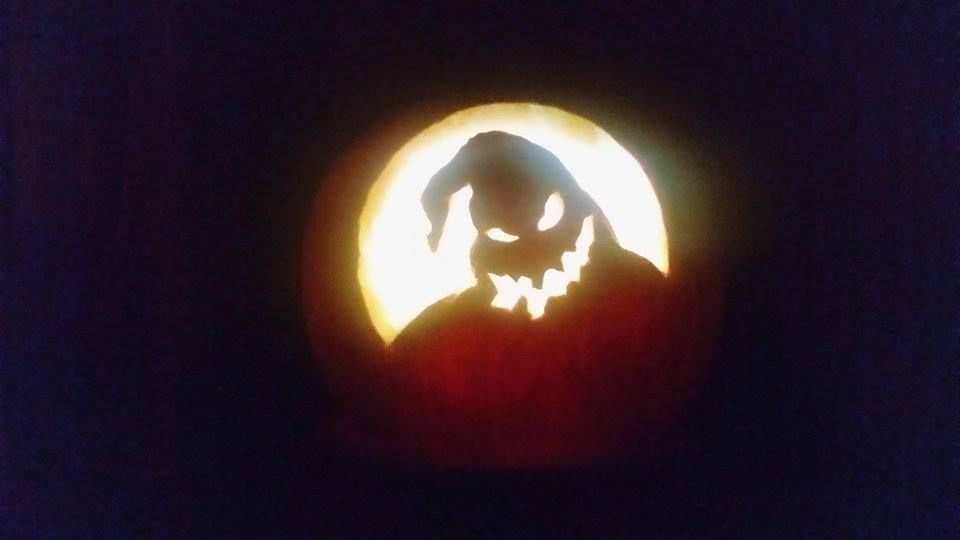 I carved this Nightmare Before Christmas Oogie Boogie pumpkin carving for halloween all by myself. This is what it looks like all lit up without room lighting