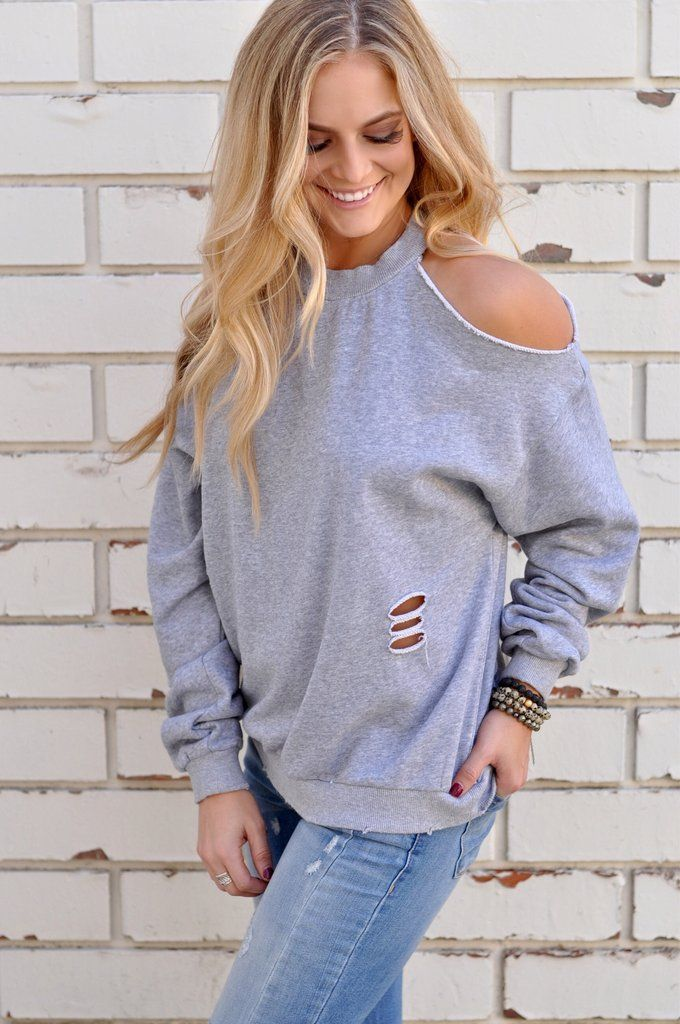 1beb0577d04289 A cold shoulder sweatshirt featuring distressing and a cut out open back.  100% Cotton Hand wash Model is wearing size Small Size info: Runs true to  size ...