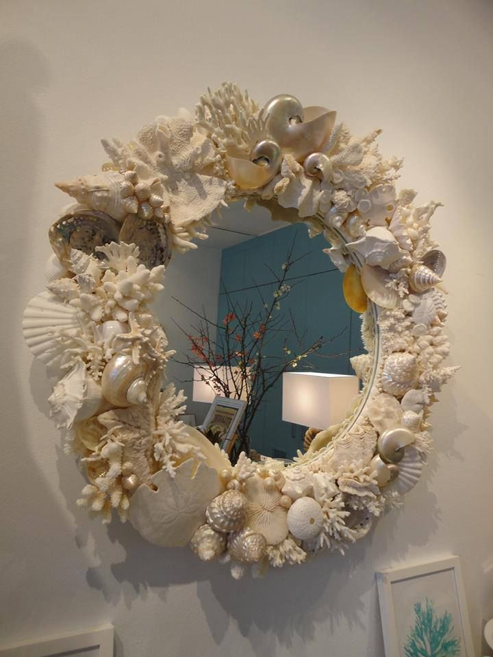 Beautiful sea shell mirror could be an inspiration for for Seashell wreath craft ideas