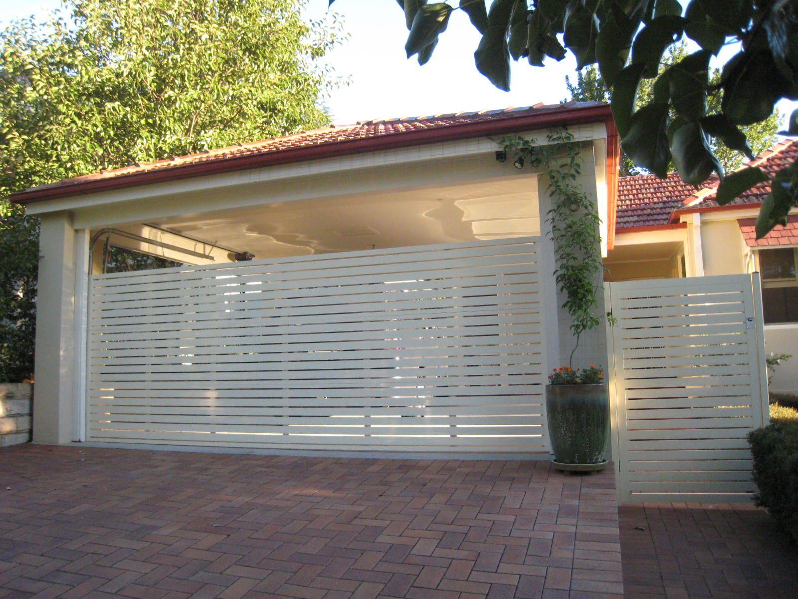 Home car ports carport ideas and garage doors for Carport fence ideas