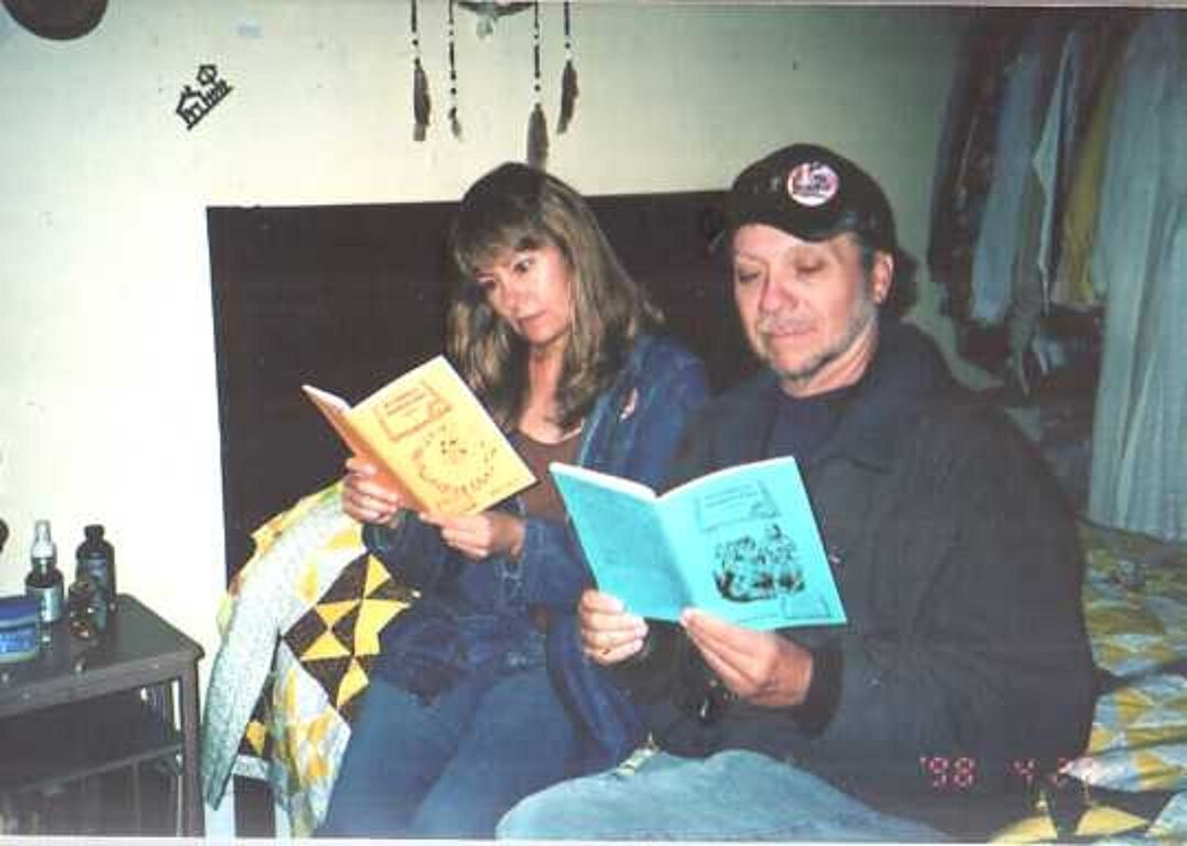 Judy Bolton fans Sharon Kissell and Mike DeBaptiste reading Susabella Passengers and Friends fanzines in a Potter County farmhouse on Judy Bolton Day weekend.