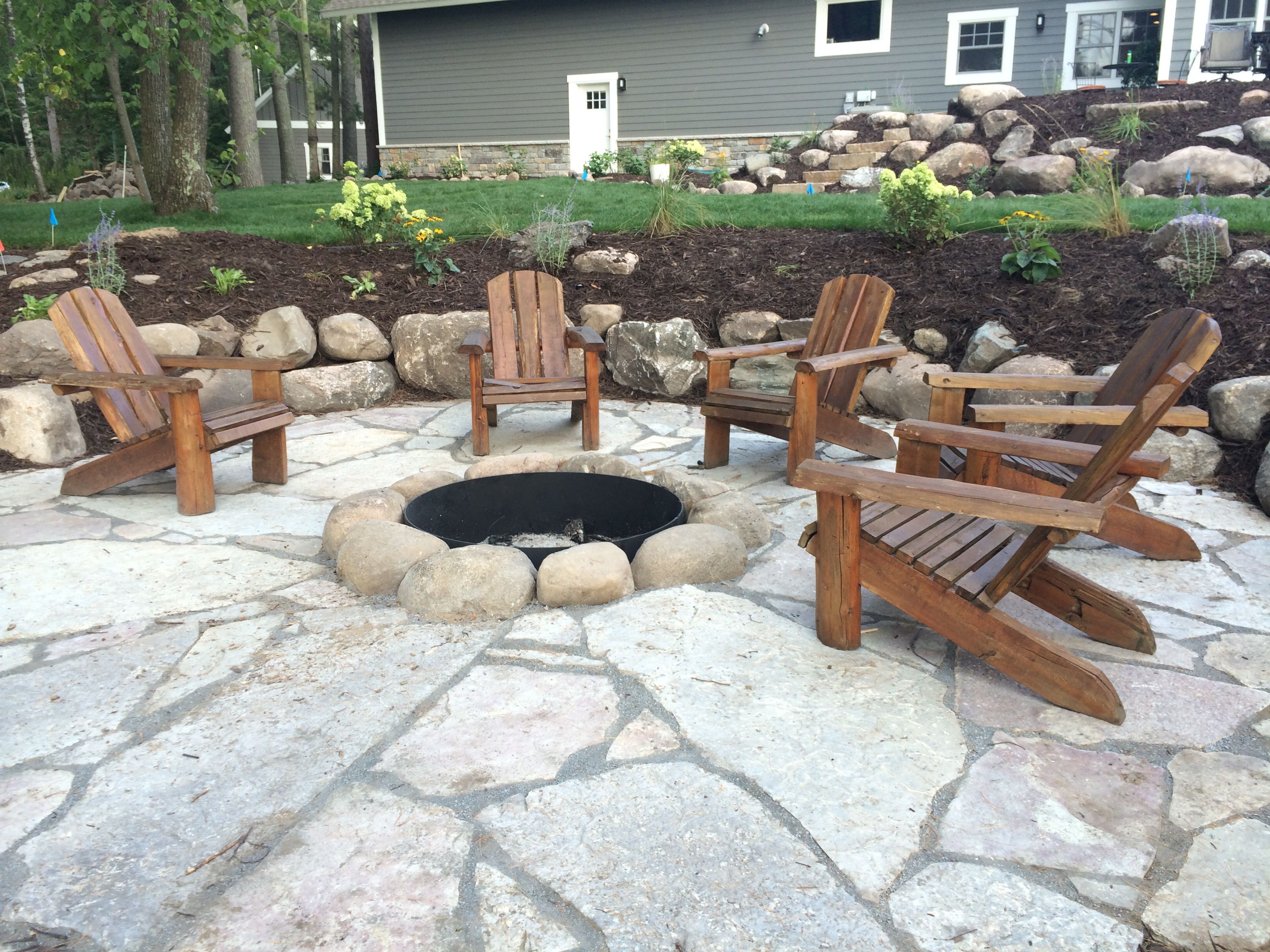 backyard fire pit built into side of small hill on backyard fire pit landscaping id=49389