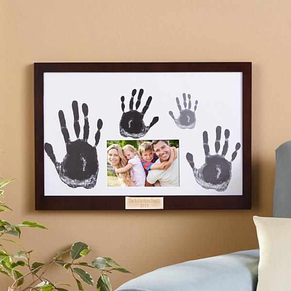 """A Personal Creations Exclusive! The whole family will love this """"hand""""some frame and the memories it creates. Personalize with a photo and everyone's handprints."""