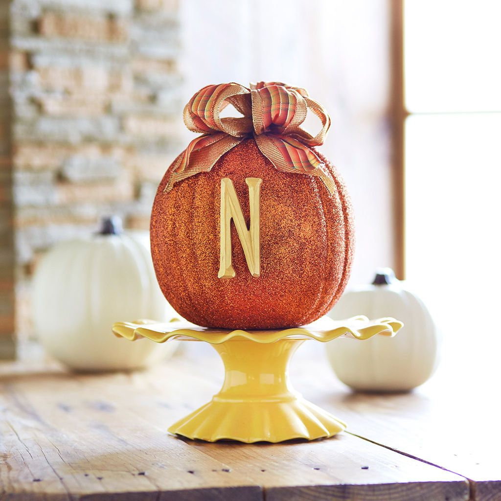 Make this easy pumpkin with glitter, monogram letter and a bow, all - michaels halloween decorations