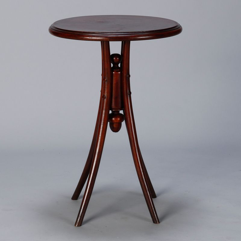 Early 20th Century Thonet Round Side Table  --  Circa 1920s Thonet round side table with four legs and decorative center joiner.  Veneer on table top shows wear and some lifting. Visible wear to legs.  --   Item:  7551  --  Retail Price:  $1195