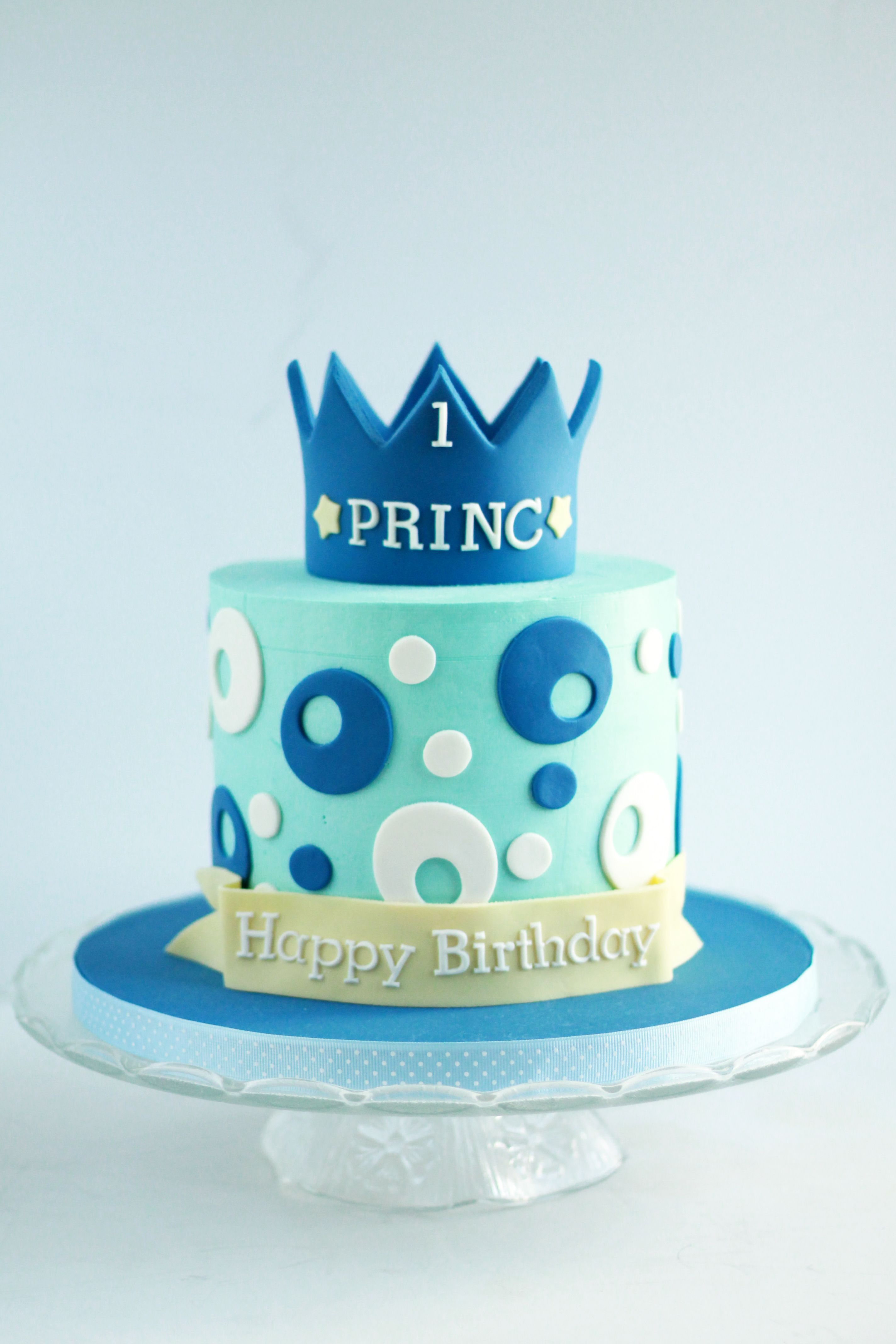 A Blue And White Polka Dot Cake With A Prince Crown For Baby Boy S