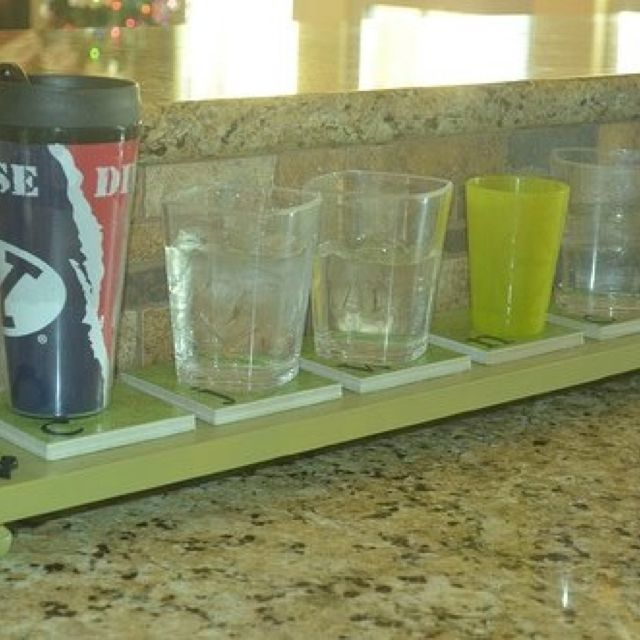 Personalized Family Coaster Board! Store drinking glasses for reuse during the day and cut down on more glasses to wash daily! BRILLIANT!!!!