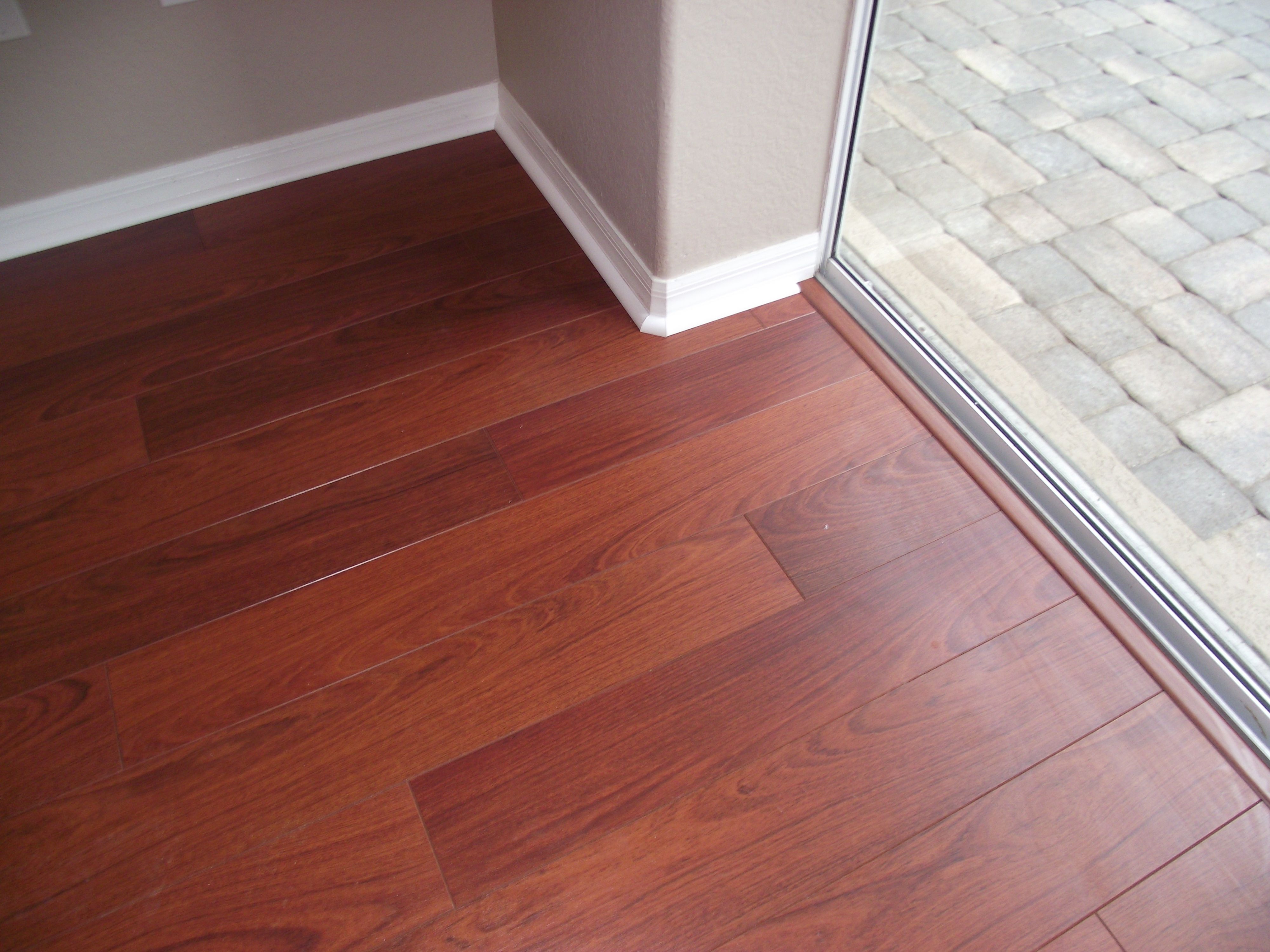 Finished laminate flooring at sliding glass door