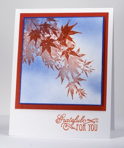 Japanese maple - image is inked in Versamark first then color ink. Sprinkle clear embossing powder and heat set. Then sponge on the background sky ink. The embossed image will resist the blue ink.