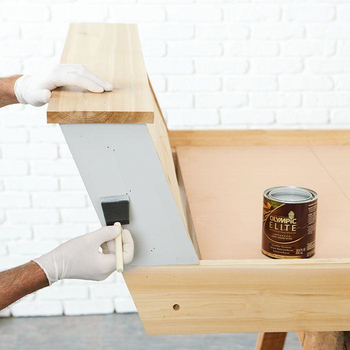 Apply the stain part-by-part with a foam brush.