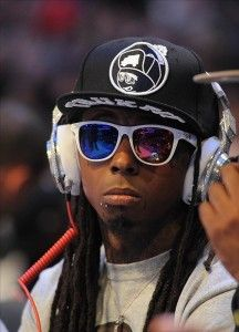 Lil wayne wearing white framed sunglasses.  0b2a96fa4d7a3