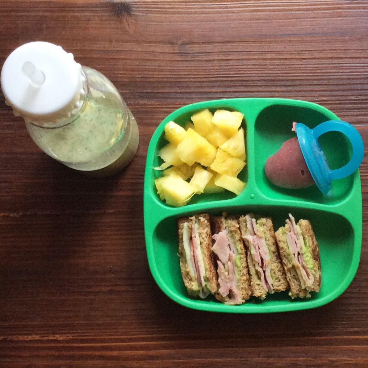 Smoothie, pineapple chunks, banana blueberry ice pop and grilled cheese sandwich with Applegate ham, mashed avocado and mozzarella cheese