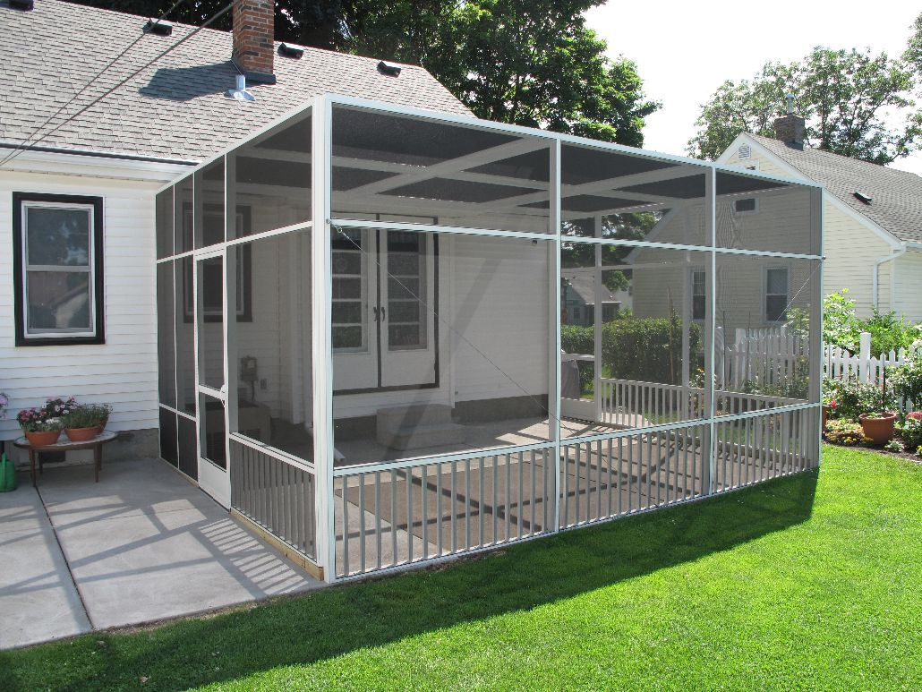 White Screen Porch Enclosure With Flat Roofline And
