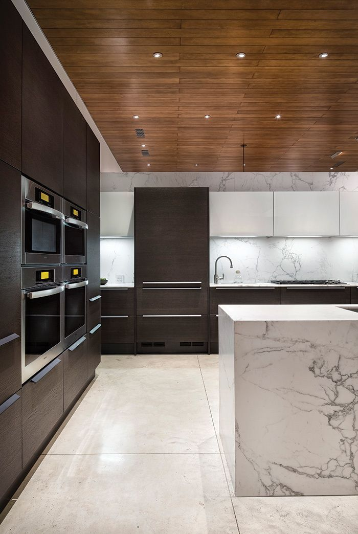 waterfall edge white marble kitchen island against seamless pedini cabinetry and miele appliances notice the - Marble Kitchen Design