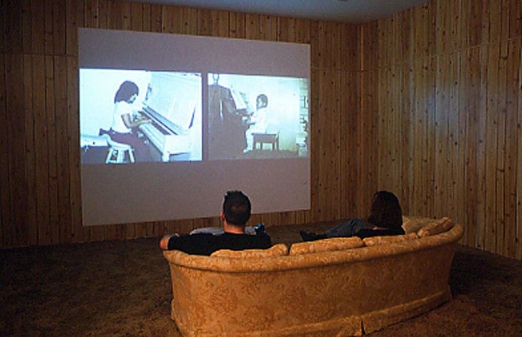 Wood paneling, shag carpet, and projection screen.