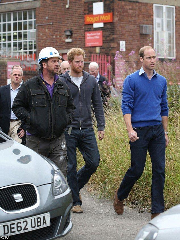 Princes William and Harry help transform a derelict street
