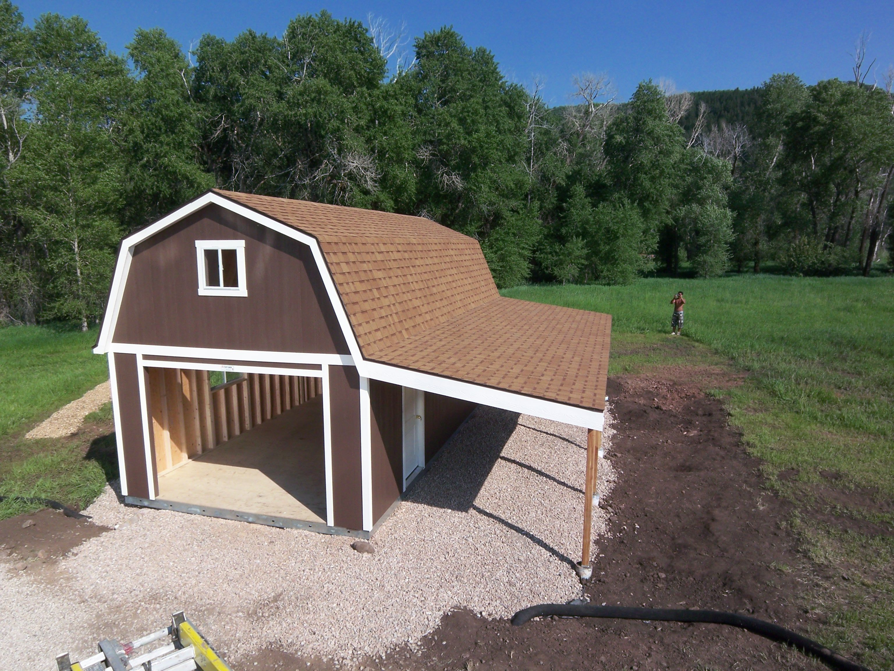 A garage a loft and a carport this tuff shed garage has for Backyard garages