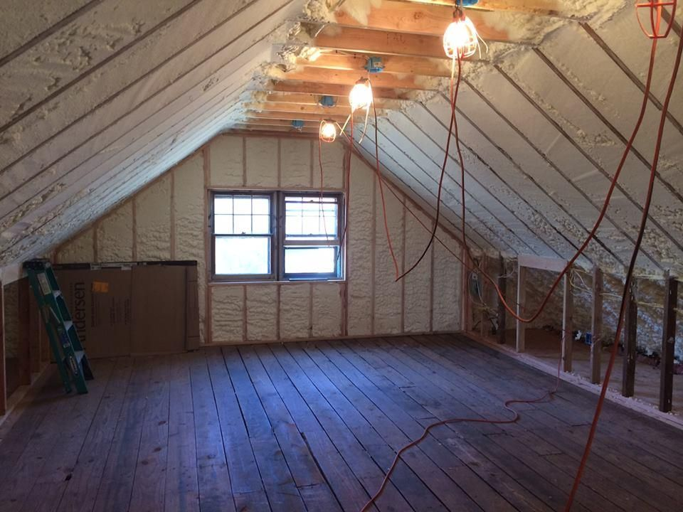 This photo shows a completed spray foamed attic. Attic