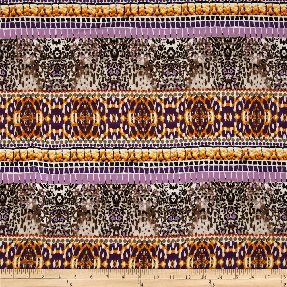 Rayon Challis Bohemian Purple/Orange from @fabricdotcom  This rayon fabric has a beautiful fluid drape and soft hand. It is perfect for creating shirts, blouses, gathered skirts and flowing dresses with a lining. Colors include brown, dusty blue, cream, sage, and black.