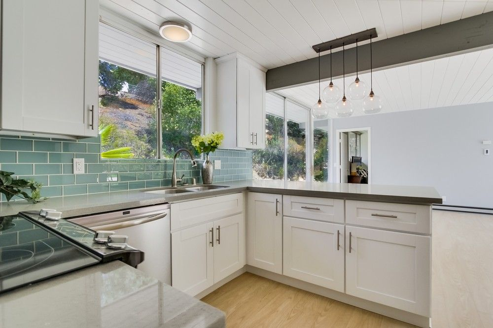 Mid century modern kitchen with white cabinets quartz for White kitchen cabinets with glass