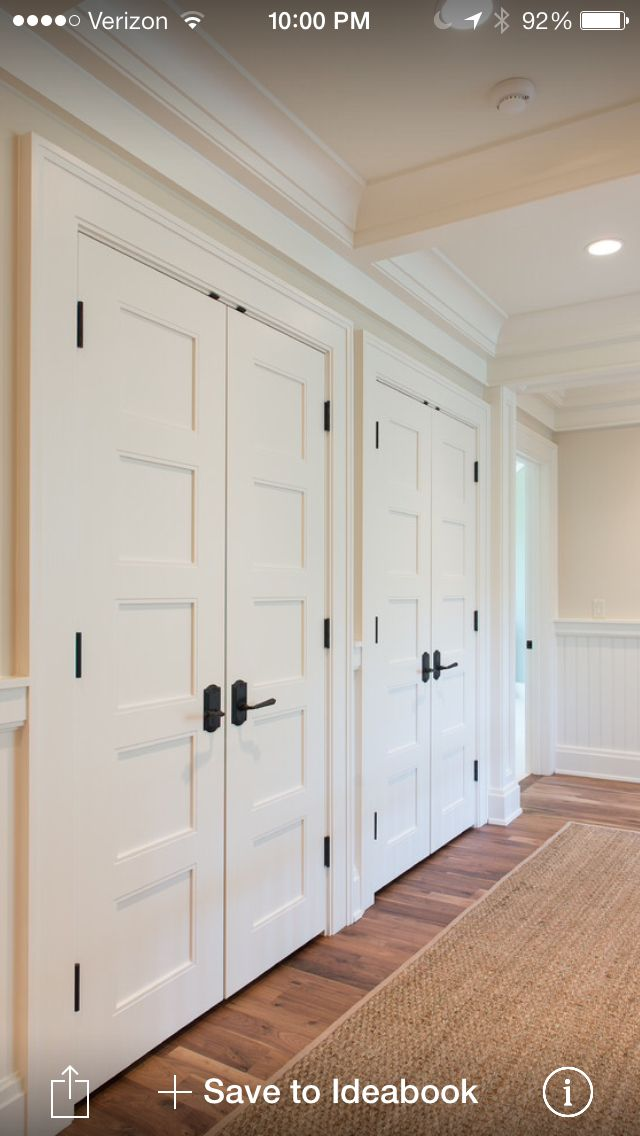 Bedroom white closet doors with dark exposed hinges for Closet door ideas