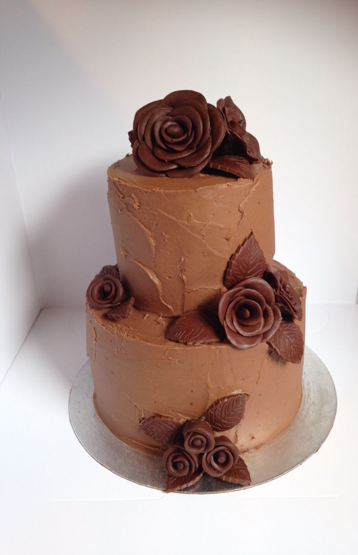 Chocolate cake covered in milk chocolate ganache and dark chocolate roses