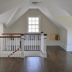 Convert Garage Into Living Room And Put Stair Entrance There.