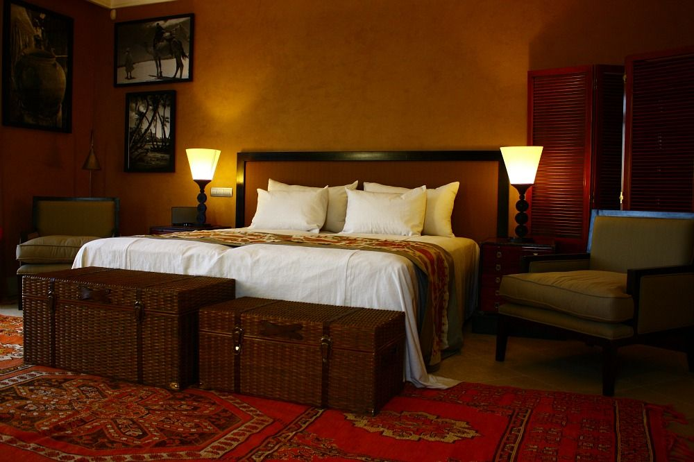Awesome Sleek Moroccan Style Room With Dim Lights Also Wicker Trunks And Red  Headboard