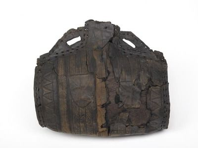 Leather was used for making light, unbreakable bottles for carrying drink on a journey. Soaked in water, the leather could be shaped around a pattern or 'former' and would retain its shape when dry. Costrels were barrel-shaped, and had lugs with holes on either side of the mouth so that they could be carried on a cord worn on the belt or round the neck. This one is decorated with shields.  Production Date: Late Medieval; late 14th century  Museum of London