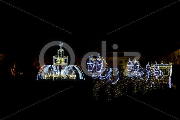 qdiz stock photos illuminated sculptures of horses with carriage and fountain art backdrop