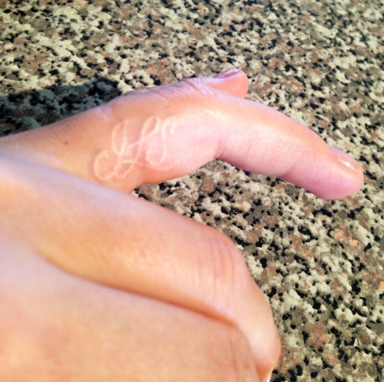 Ring On Left Ring Finger: Left Ring Finger White Ink Tattoo