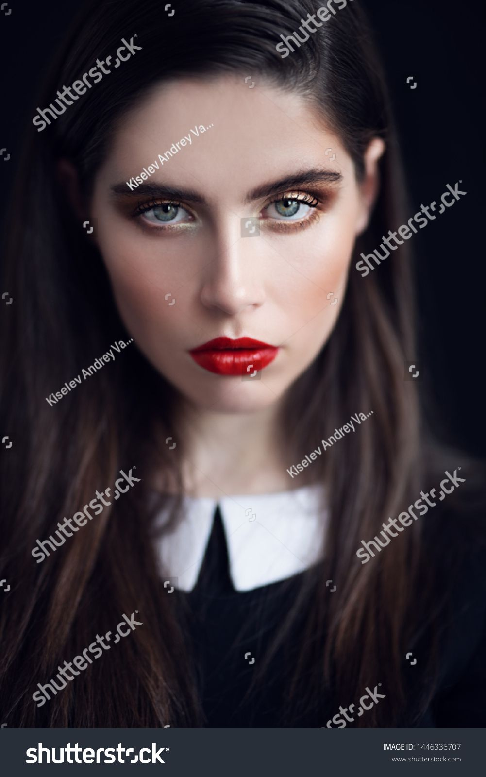 A Close Up Portrait Of A Beautiful Dark Haired Young Woman Posing