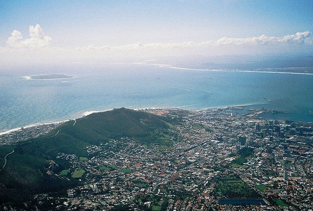 Cape Town: view from Table Mountain. Background left: Robben Island, where Nelson Mandela spent most of his years in prison.     Awesome South Africa.