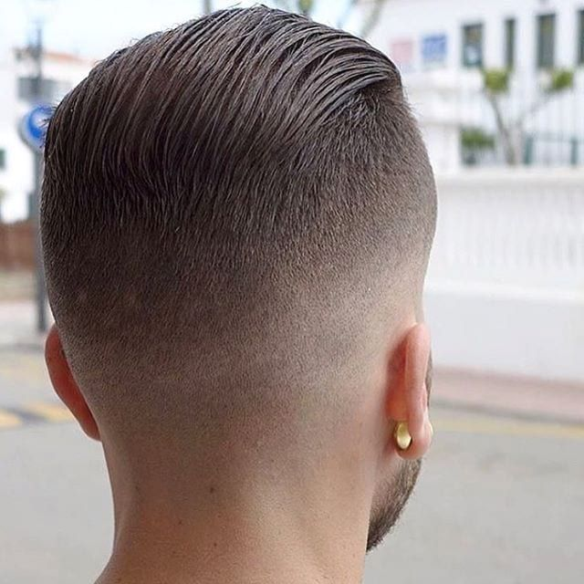 Slicked Back Undercut The Latest Hairstyles For Men And Women 2020 Hairstyleology Slick Back Haircut Short Slicked Back Hair High Fade Haircut