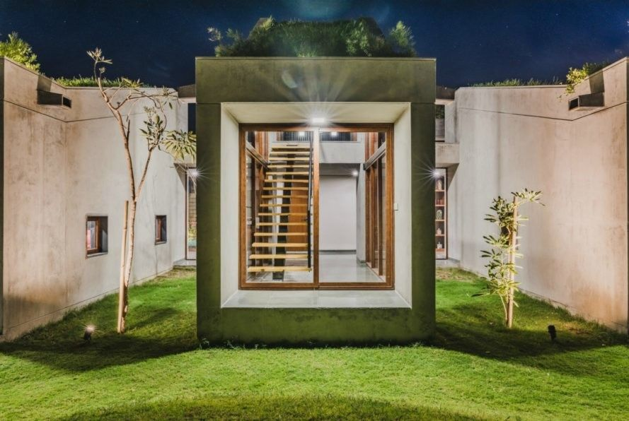 stunning home in india blends into the earth with segmented green