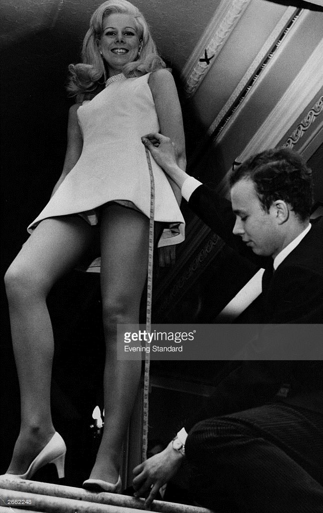 3094068fcb8 Model Linda Goldstraw being measured from waist to foot ...