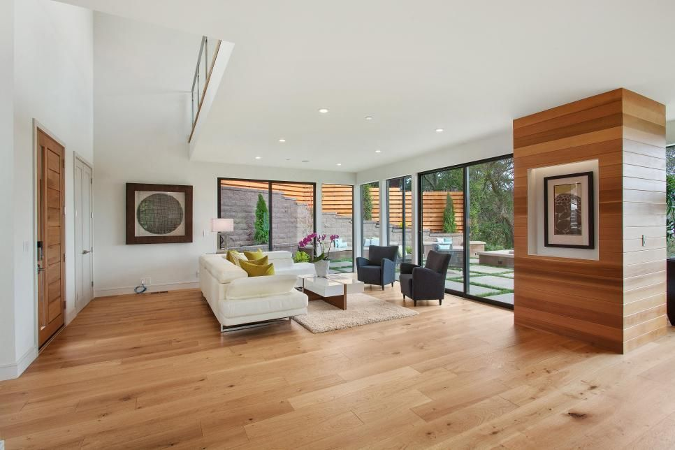 Contemporary Living Room With White Sofa And Hardwood Floors Open Concept Living Room Contemporary Living Room Fireplace Surrounds