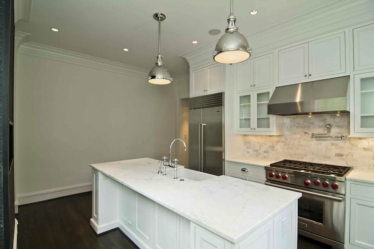 Suzie: Natalie McCorkle - Sleek kitchen with floor to ceiling white shaker cabinets paired with ...