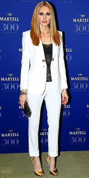 Elisabeth Moss's best outfits, celebrity red carpet photos #whitepantsuit Last Night's Look: Love It or Leave It? | OLIVIA PALERMO | in a white La Perla suit, sheer black bustier top and gold peep toe pumps at the Martell 300th Anniversary event in Versailles, France. #whitepantsuit