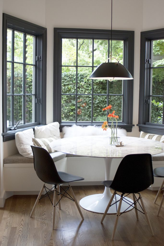 modern kitchen nook unique items breakfast with black window frame round table and eames chairs
