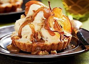 Caramel Apple Ice Cream Tarts.... 1-2/3 cups all-purpose flour  3/4 cup butter, cubed  2/3 cup powdered sugar  1/3 cup cornstarch  2 tablespoons butter  2 cups peeled and diced Gala apples  1/3 cup firmly packed light brown sugar  2 tablespoons bourbon  2 pt. vanilla ice cream  Caramel Sauce  1/2 cup lightly salted roasted pecans  Garnish: Caramelized Apple Chips