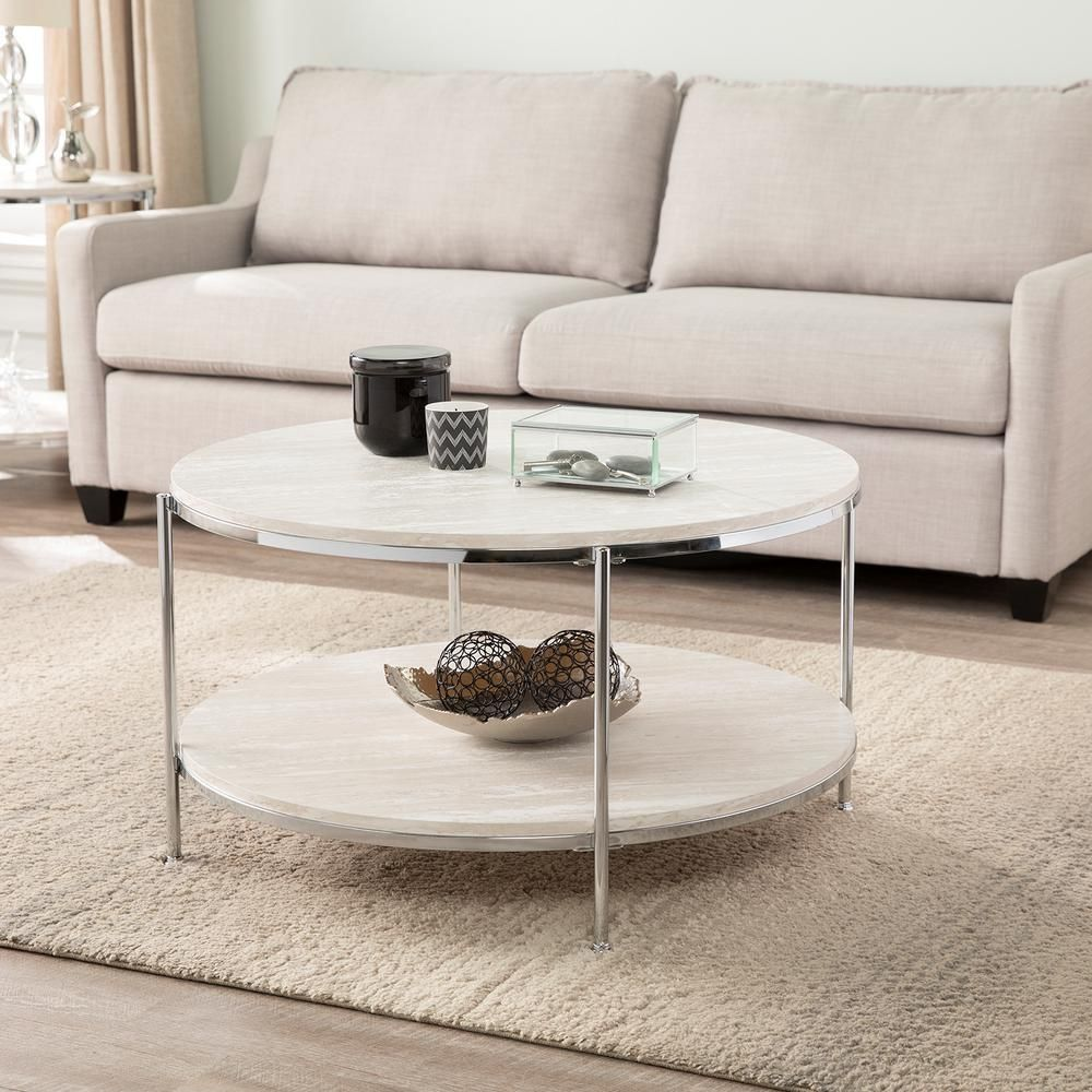 Southern Enterprises Kaitlyn 34 In Chrome Medium Round Resin Coffee Table With Shelf Hd698472 The Home Depot Coffee Table Stone Coffee Table Coffee Tables For Sale [ 1000 x 1000 Pixel ]