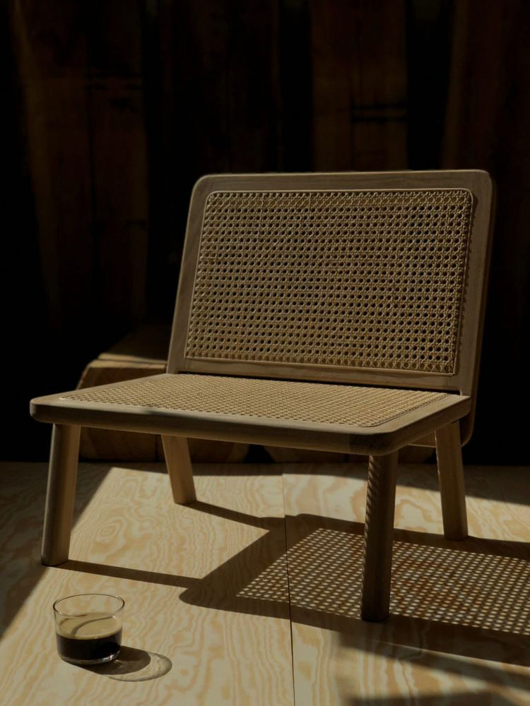 Best A Minimalist Lounge Chair In Oak And Rattan September 400 x 300