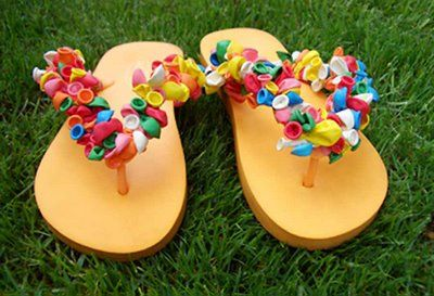 DIY: Balloon Flip Flops ***Supplies: *200 water balloons  *Flip Flops ***Directions:   Double knot the water balloons around the thong of the flip flop. You can create fun patterns or use all the same color...get creative! :-)