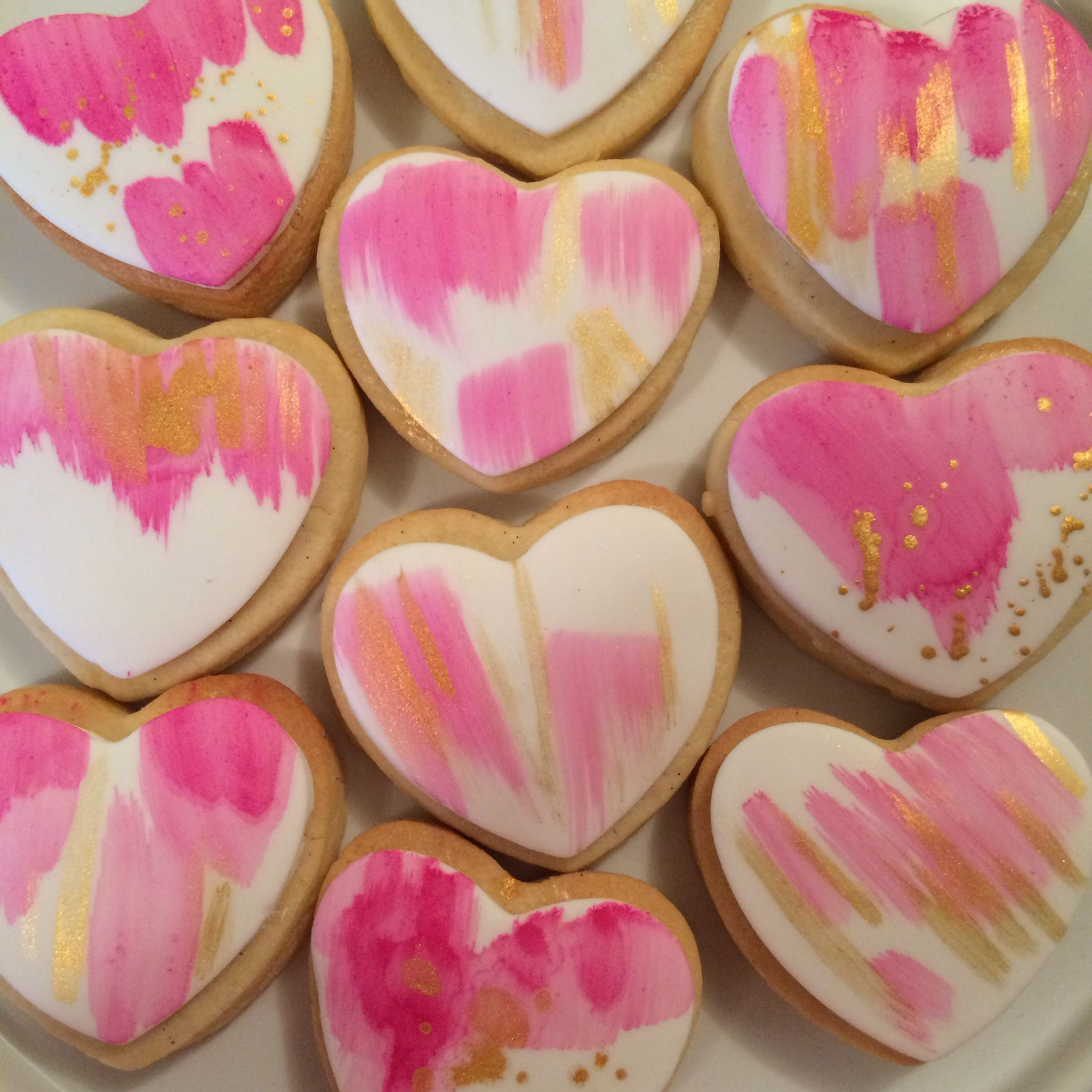 Pink and gold hand painted heart cookies. By Vanilla Rose Cakery