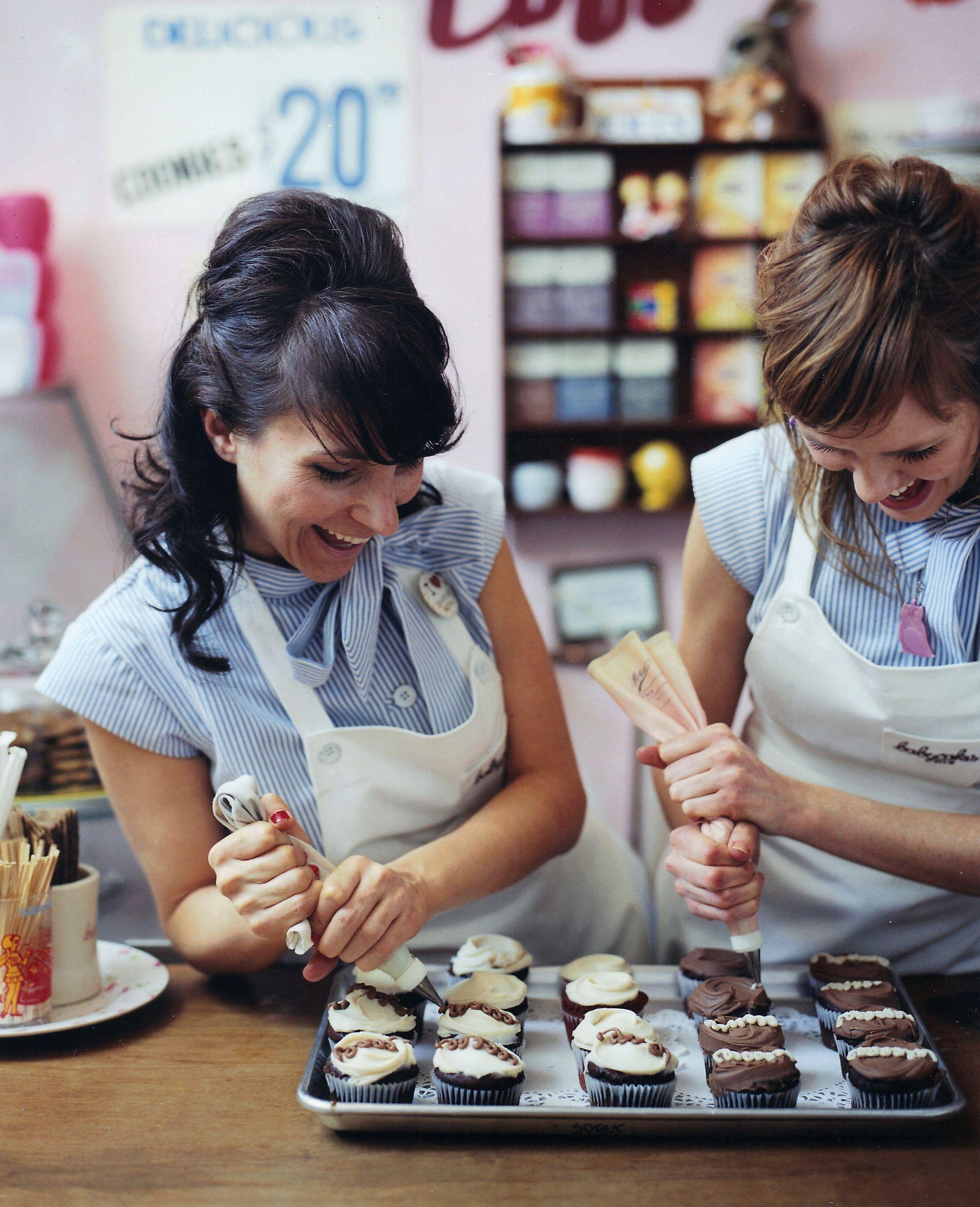 Babycakes girls piping curlicues onto cupcakes cupcake