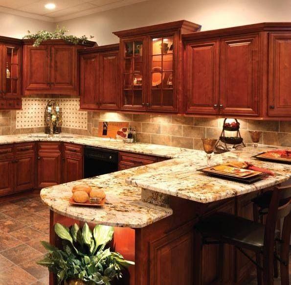 Granite countertop and tile backsplash. I love the tan ... on Backsplash Ideas For Black Granite Countertops And Cherry Cabinets  id=67875