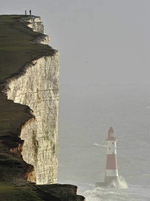 The white cliffs, the channel, and Beachy Head lighthouse in East Sussex, UK